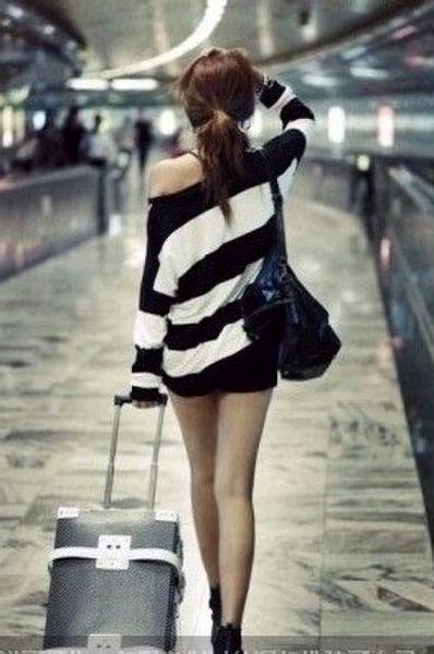 拉着行李箱背影的图片_拉行李箱背影图片